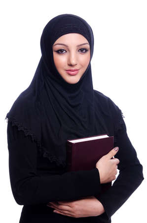 Young muslim woman with book on white Stock Photo - 19675039