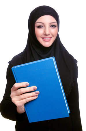 Young muslim woman with book on white Stock Photo - 19675054