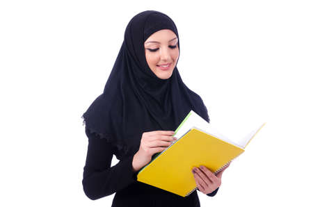 Young muslim woman with book on white Stock Photo - 19674474