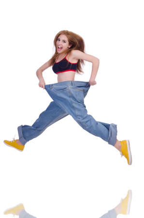 Woman in dieting concept with big jeans Stock Photo - 20083301