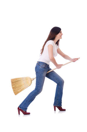 Young woman with broom isolated on white Stock Photo - 19642717
