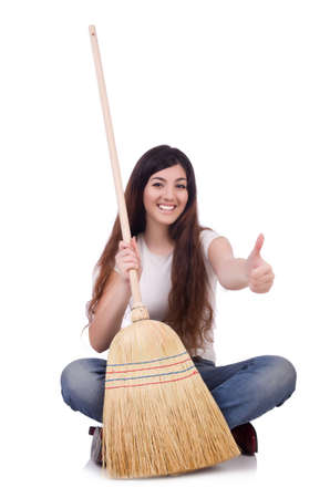 Young woman with broom isolated on white Stock Photo - 19673982