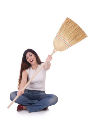 Young woman with broom isolated on white Stock Photo - 19673129