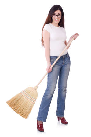 Young woman with broom isolated on white Stock Photo - 19674450