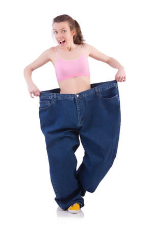 Woman in dieting concept with big jeans Stock Photo - 19674736