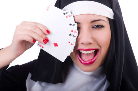 Nun playing cards on white Stock Photo - 19674949