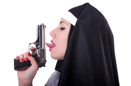 Nun with gun isolated on the white photo