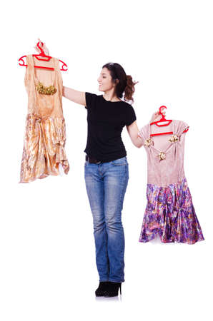 Woman trying to choose dress on white photo
