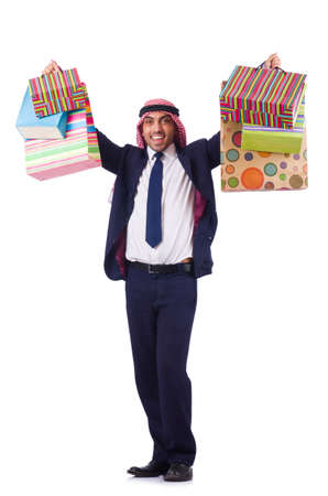 Arab man with shopping gifts on white photo