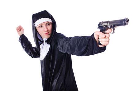 Nun with handgun isolated on white Stock Photo - 20258667