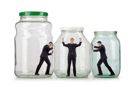 Young businessman in glass jar Stock Photo