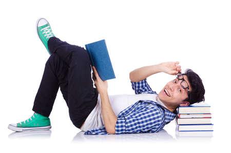Estudiante con un mont?n de libros en blanco Foto de archivo