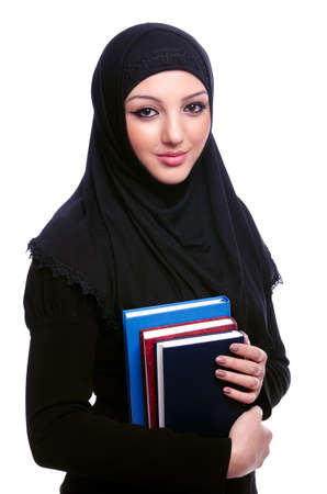 Young muslim woman with book on white Stock Photo - 21110097