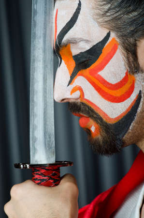 Man with sword and face mask photo
