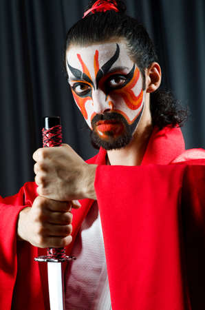 Man with sword and face mask Stock Photo - 20258722