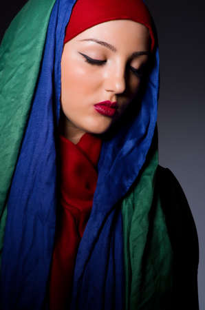 burka: Muslim woman with headscarf in fashion concept Stock Photo