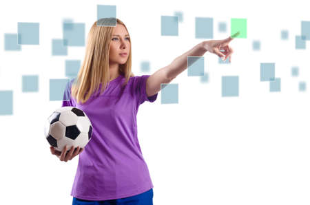 Woman with football pressing virtual buttons photo