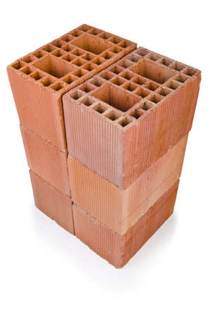 Stack of clay bricks isolated on white Stock Photo - 19653884
