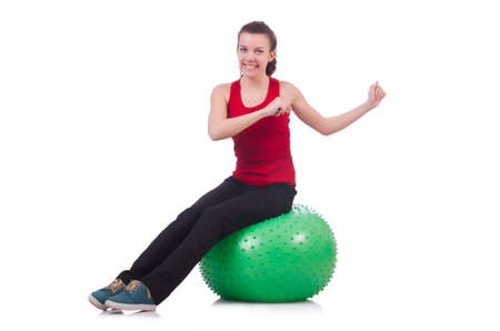 Young woman with ball exercising on white Stock Photo - 20101593