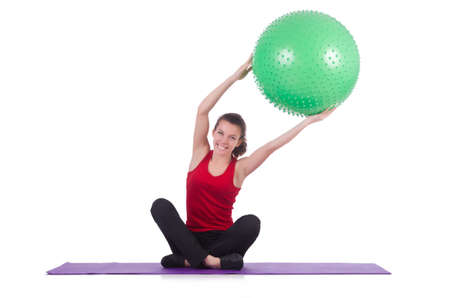 Young woman with ball exercising on white Stock Photo - 20101594