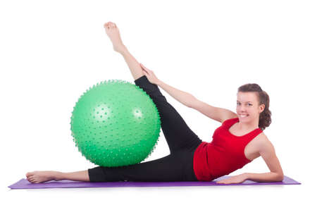 Young woman with ball exercising on white Stock Photo - 20101598