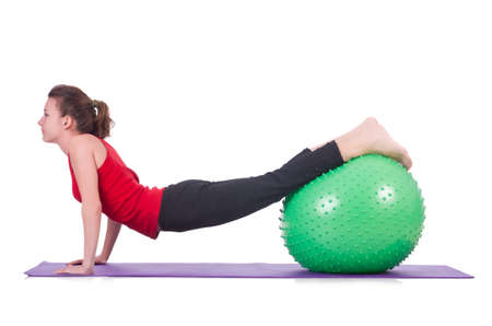 Young woman with ball exercising on white Stock Photo - 20101595