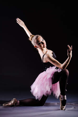 Ballerina dancing in the dark studio Stock Photo - 20101610