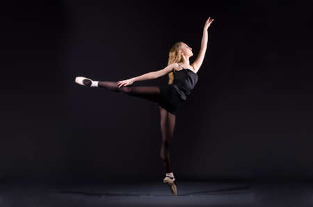 Ballerina dancing in the dark studio Stock Photo - 20258777