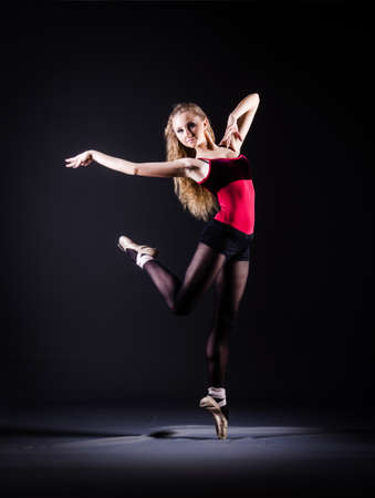 Ballerina dancing in the dark studio Stock Photo - 20258784