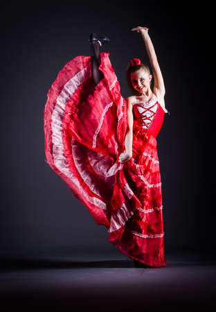 Girl in red dress dancing dance Stock Photo - 20258792