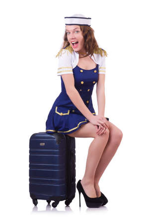 Woman travel attendant with suitcase on white Stock Photo - 20258764
