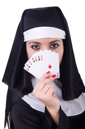 Nun playing cards on white Stock Photo - 20258790