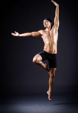 Dancer dancing in the dark studio Stock Photo - 20258786