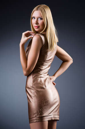 Woman in fashion concept with golden dress Stock Photo - 20258797