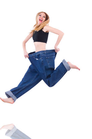 Woman in dieting concept with big jeans Stock Photo - 19869120