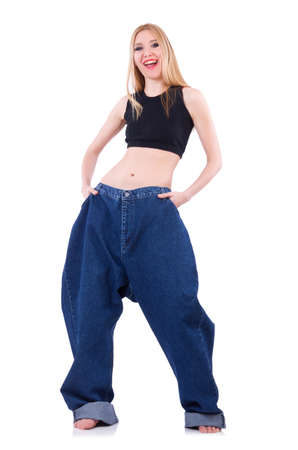 Woman in dieting concept with big jeans Stock Photo - 19869140