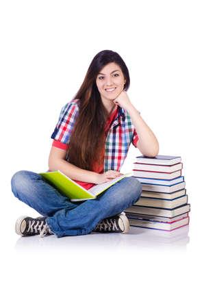 Estudiante con los libros aislados en blanco Foto de archivo