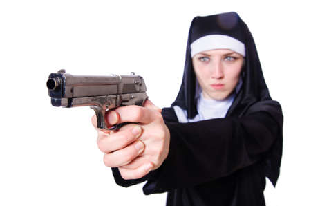 Nun with handgun isolated on white photo