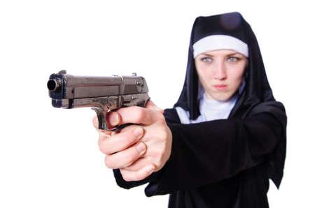 Nun with handgun isolated on white Stock Photo - 19934446