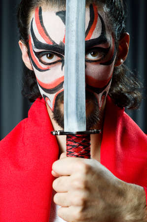 Man with sword and face mask Stock Photo - 20101665