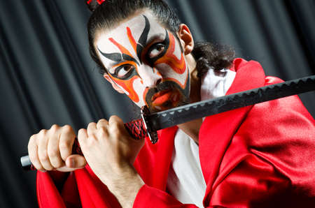 Man with sword and face mask Stock Photo - 20258804