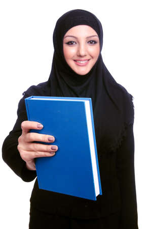 Young muslim woman with book on white Stock Photo - 20258800
