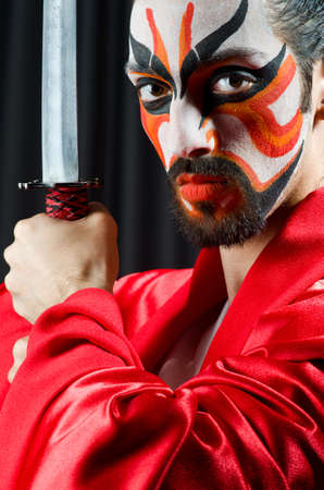 Man with sword and face mask Stock Photo - 20258803