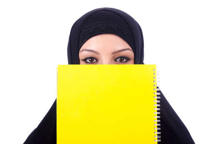 Young muslim woman with book on white Stock Photo - 20258798