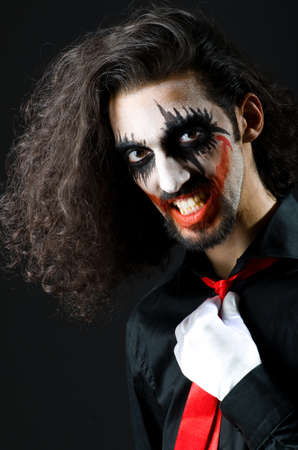 personification: Joker personification with man in dark room