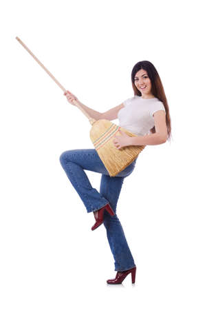 Young woman with broom isolated on white Stock Photo - 19932693