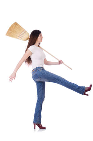 Young woman with broom isolated on white Stock Photo - 19932691