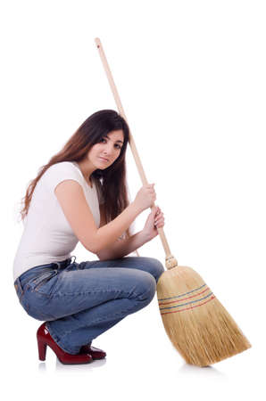 Young woman with broom isolated on white Stock Photo - 19932697