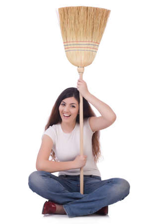 Young woman with broom isolated on white Stock Photo - 19932696