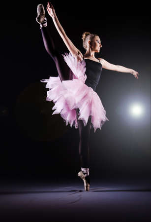 Ballerina dancing in the dark studio Stock Photo - 19933828